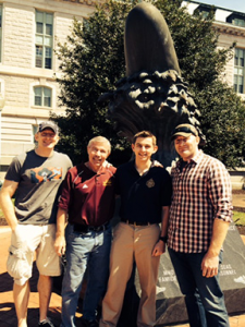 Rep. Dettmer with his sons Majors Rob and Travis Dettmer and Cadet Justin Keck at the Naval Academy